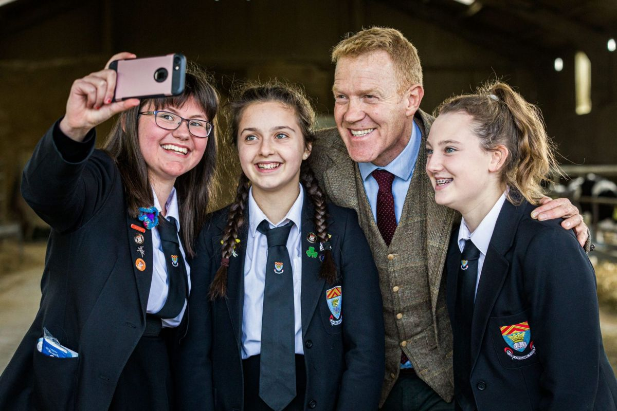Adam Henson with school girls