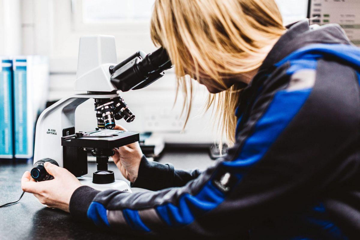 female using a microscope