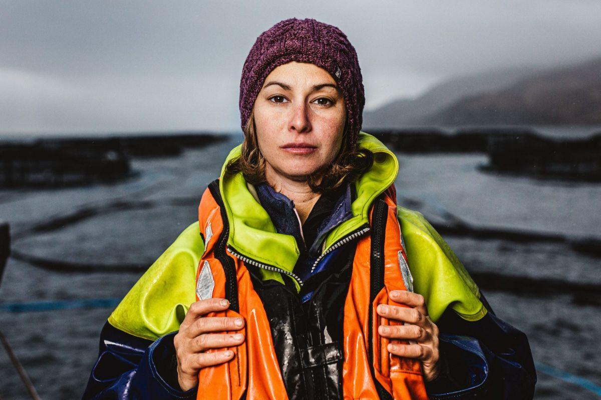 female salmon farmer look to camera
