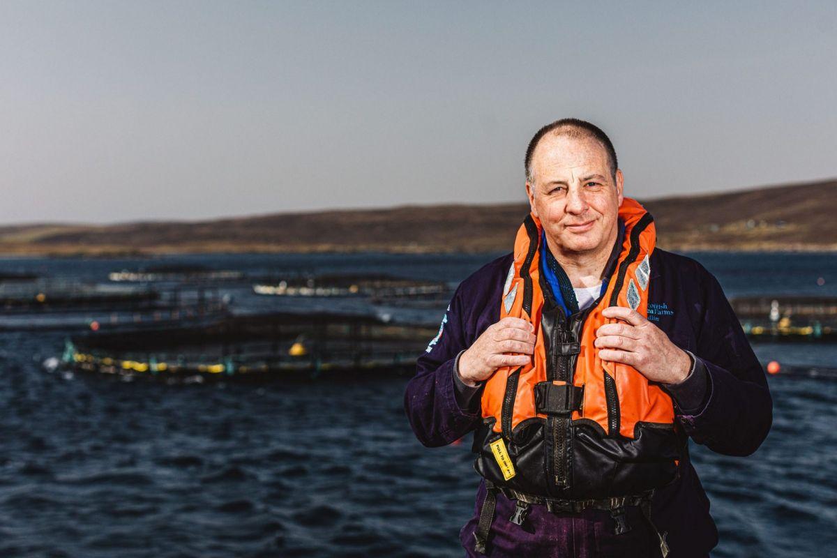 shetland salmon farmer in sun