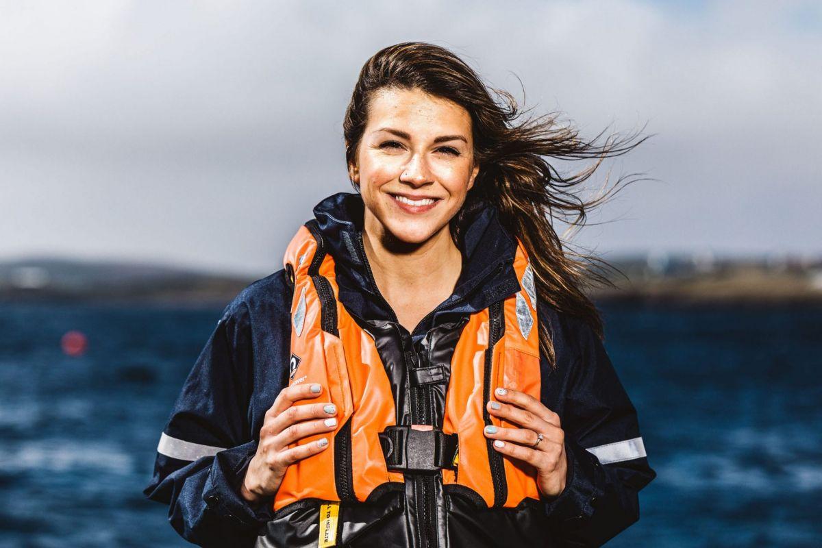 female salmon farmer with wind in hair