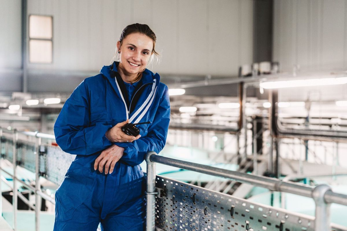 young female salmon hatchery worker