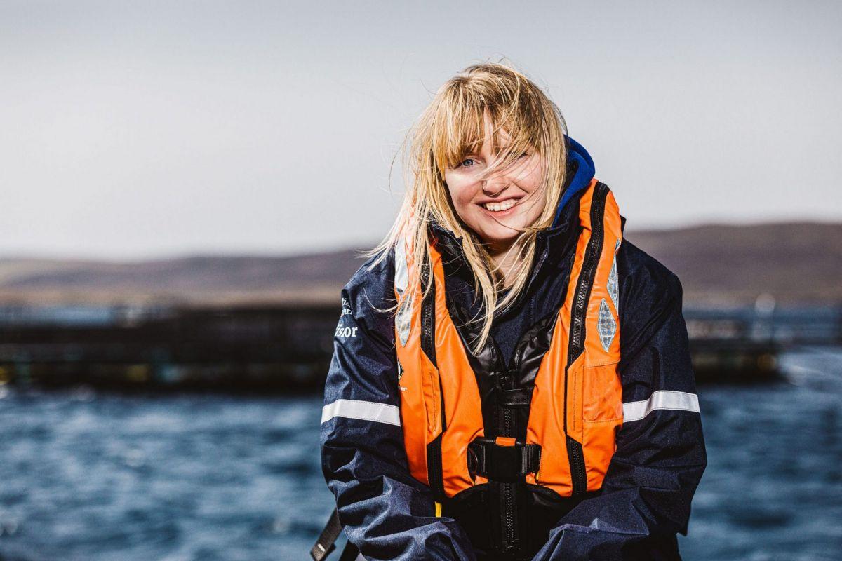 young female salmon farmer in shetland