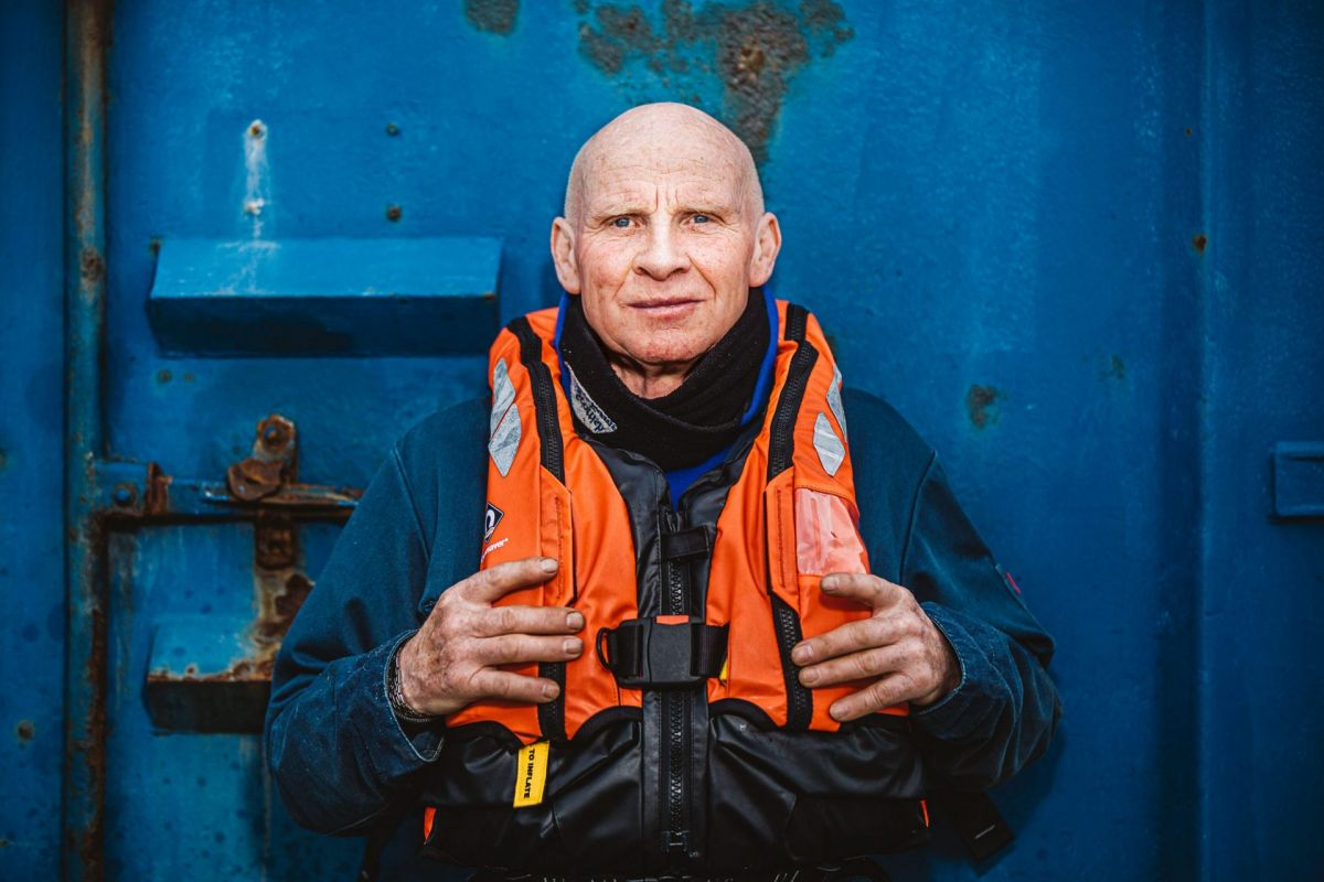 older man with lifejacket on