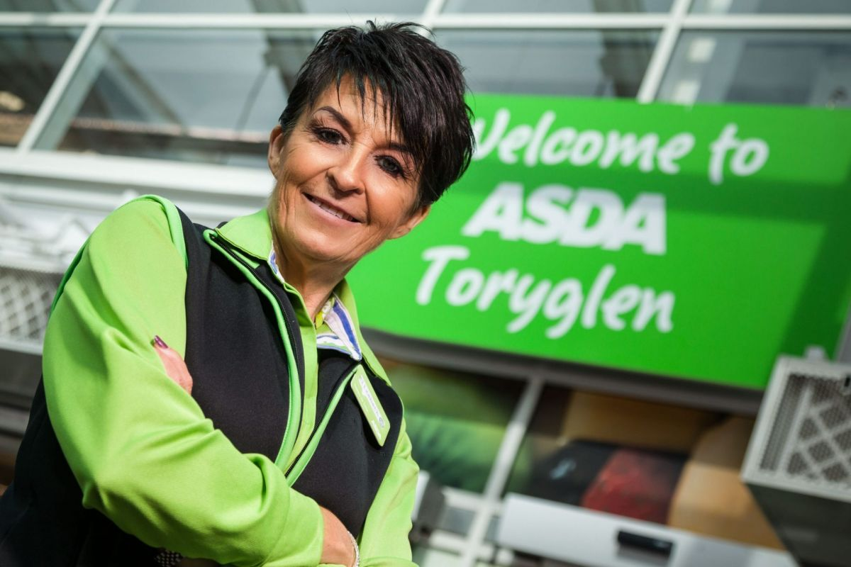 Asda worker with signage