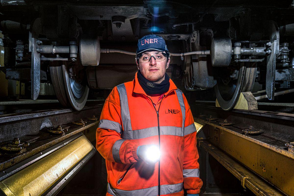 Apprentice LNER engineer under a HST train