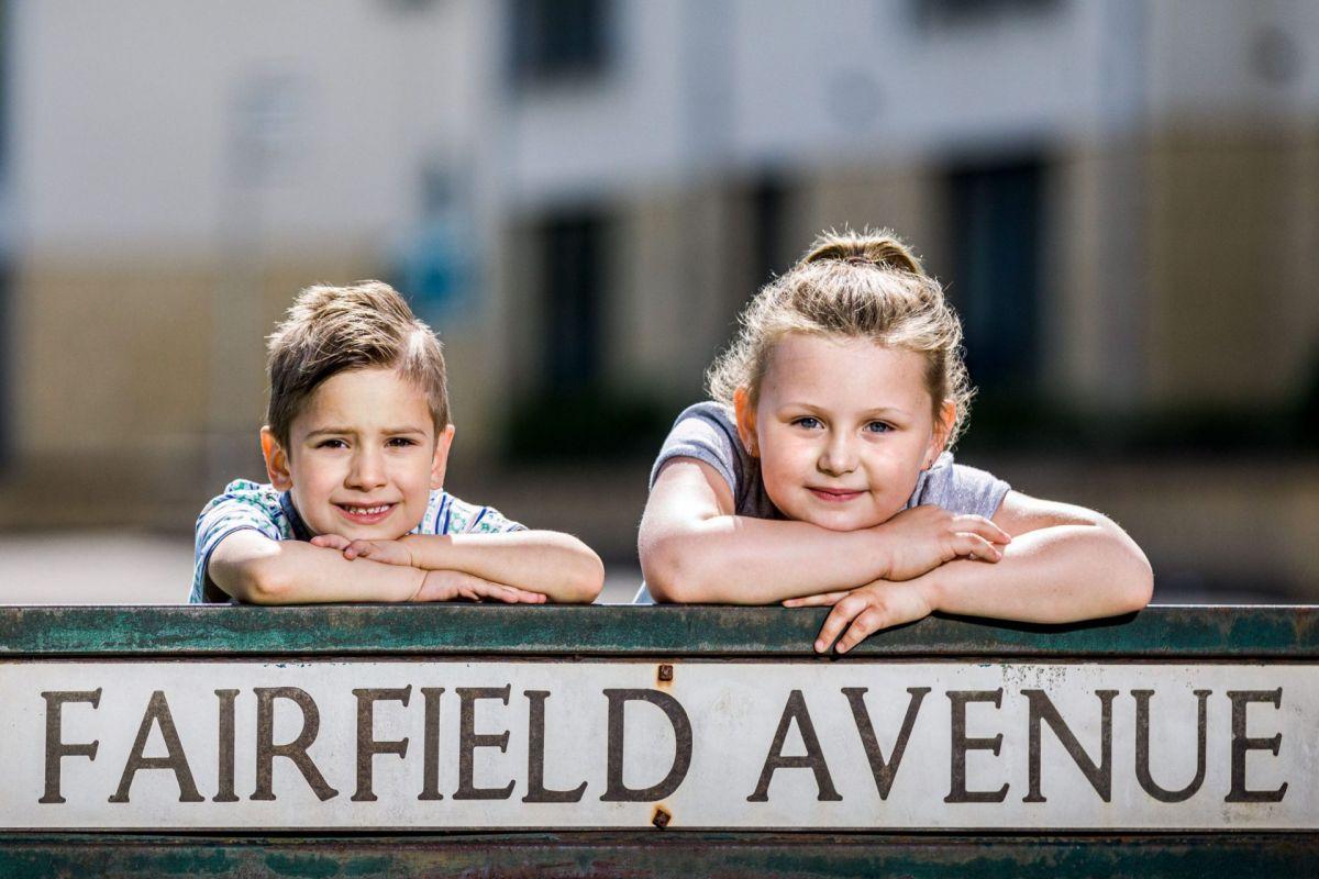 children with Fairfield street sign