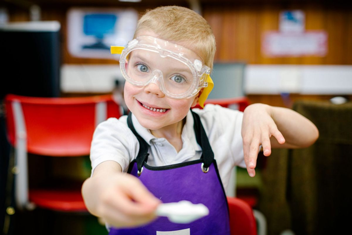young school boy with goggles on