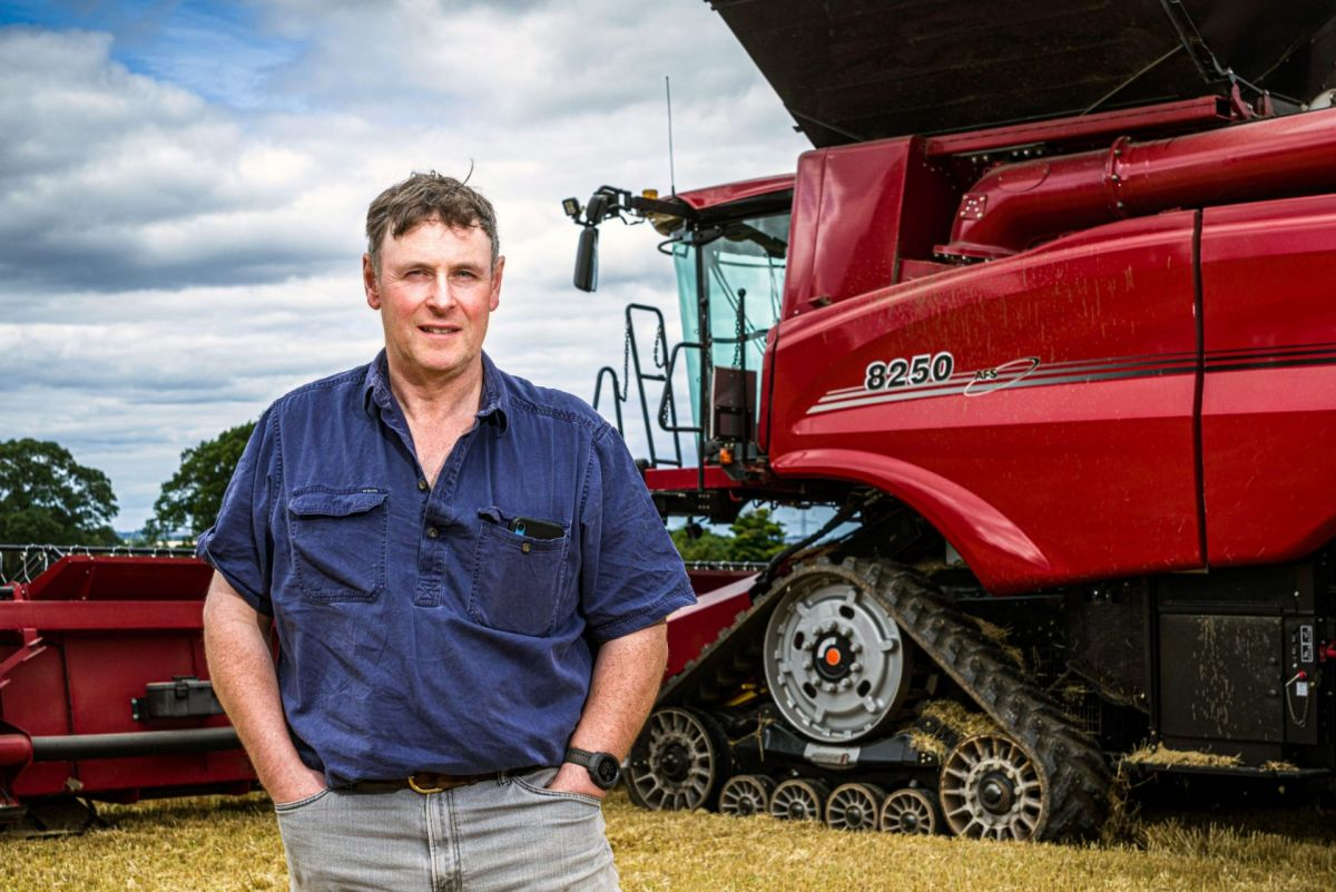 man with Case IH combine harvester
