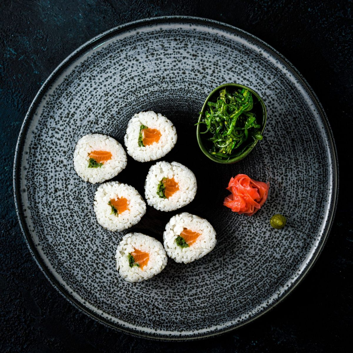 plate of salmon sushi from above
