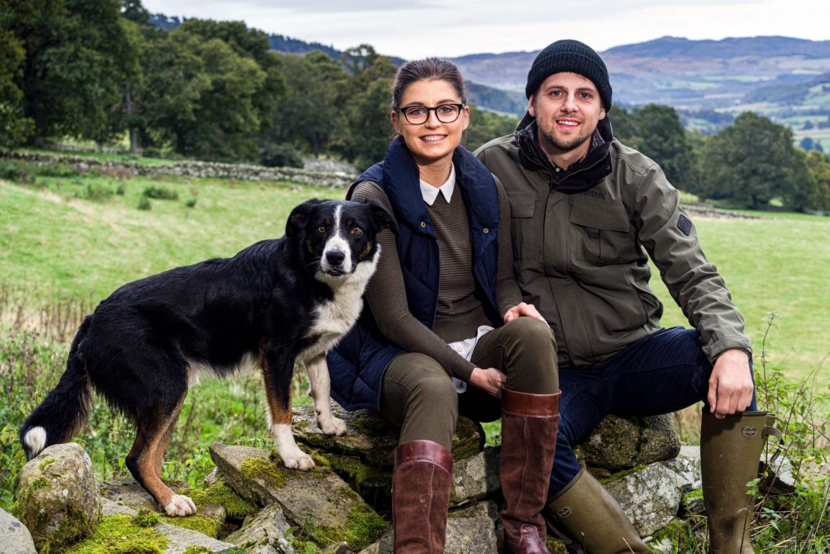 Young farming couple with collie dog